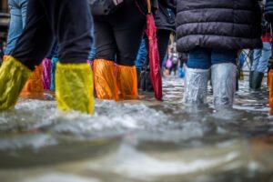 various people standing in flood water